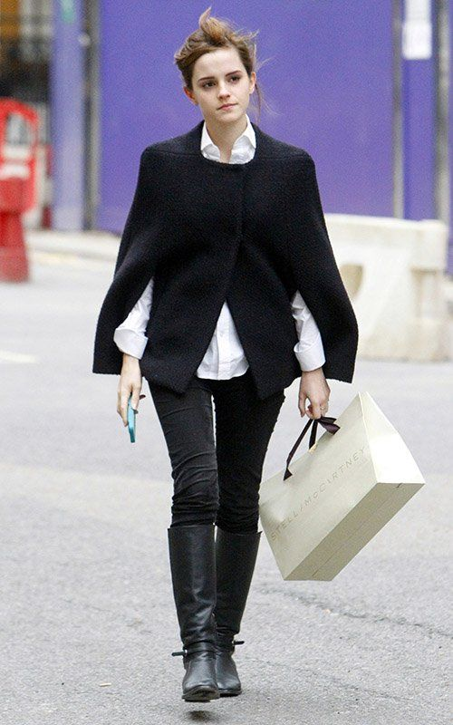 Emma Watson in black cape, white button down, and riding boots ...