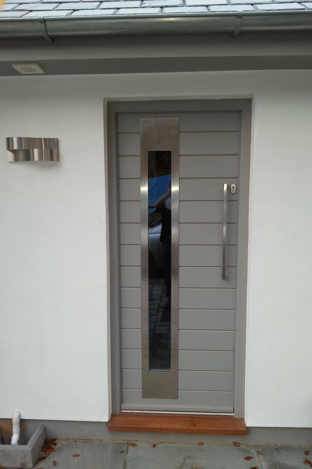 This contemporary door looks great with it 39 s stainless for Office door entrance designs