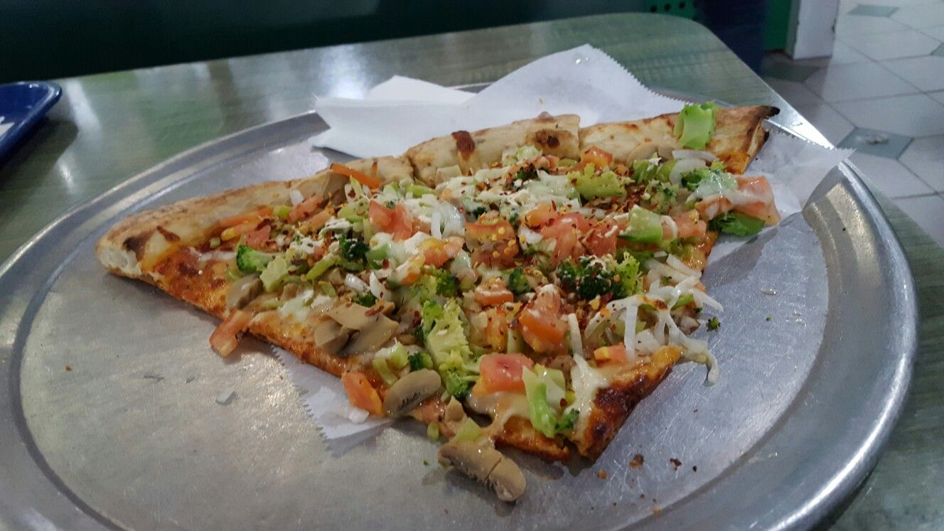 Here Are 2 Slices Of Cheese Pizza With Vegetables At Pizzeria Los Bravos In Cidra Puerto Rico