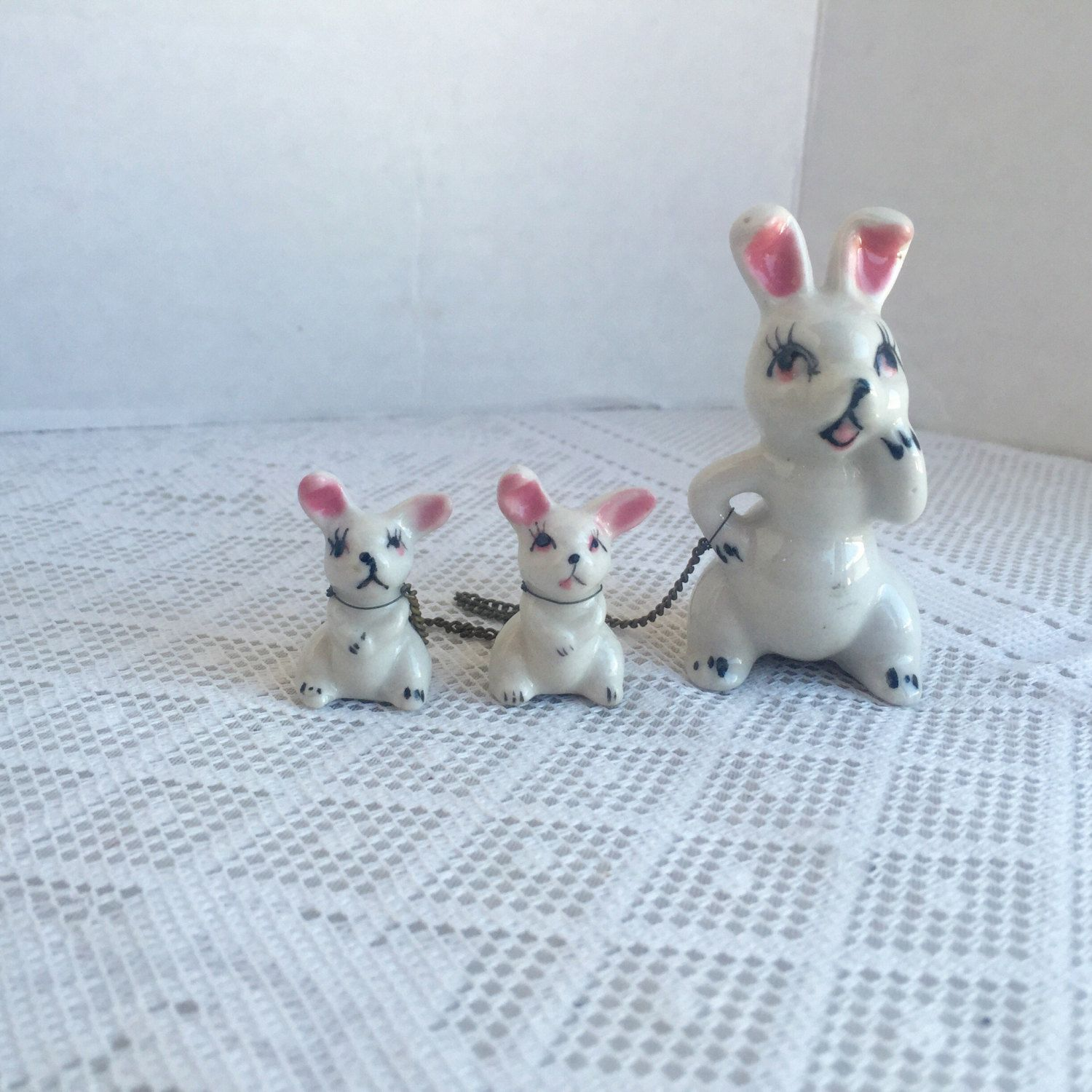 Vintage white rabbit family figurines ceramic easter bunny set vintage white rabbit family figurines ceramic easter bunny set of three chained together rabbits negle Image collections