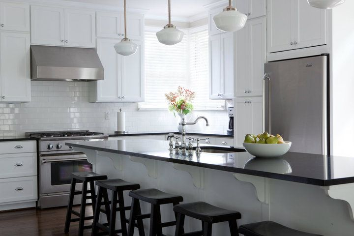 Gorgeous Black And White Kitchen With Extended Kitchen Island.