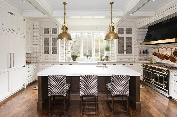 U Shaped Kitchen Features Country Industrial Large Pendants Illuminating A Brown Oak Kitchen Island Topped Wi East Grand Rapids White Backsplash Modern Kitchen