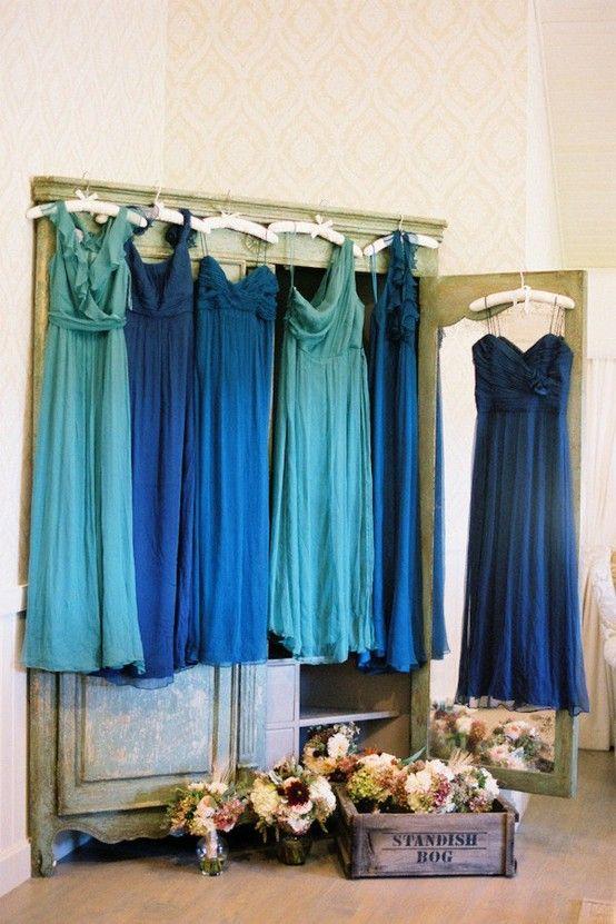 Blue bridesmaids dresses - love the missmatched idea
