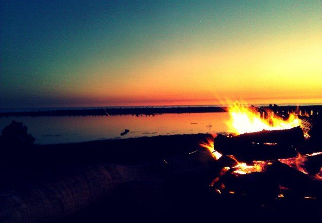 Beach Bonfire - On a beach with a fire next to the forest and calming waves and light wind.