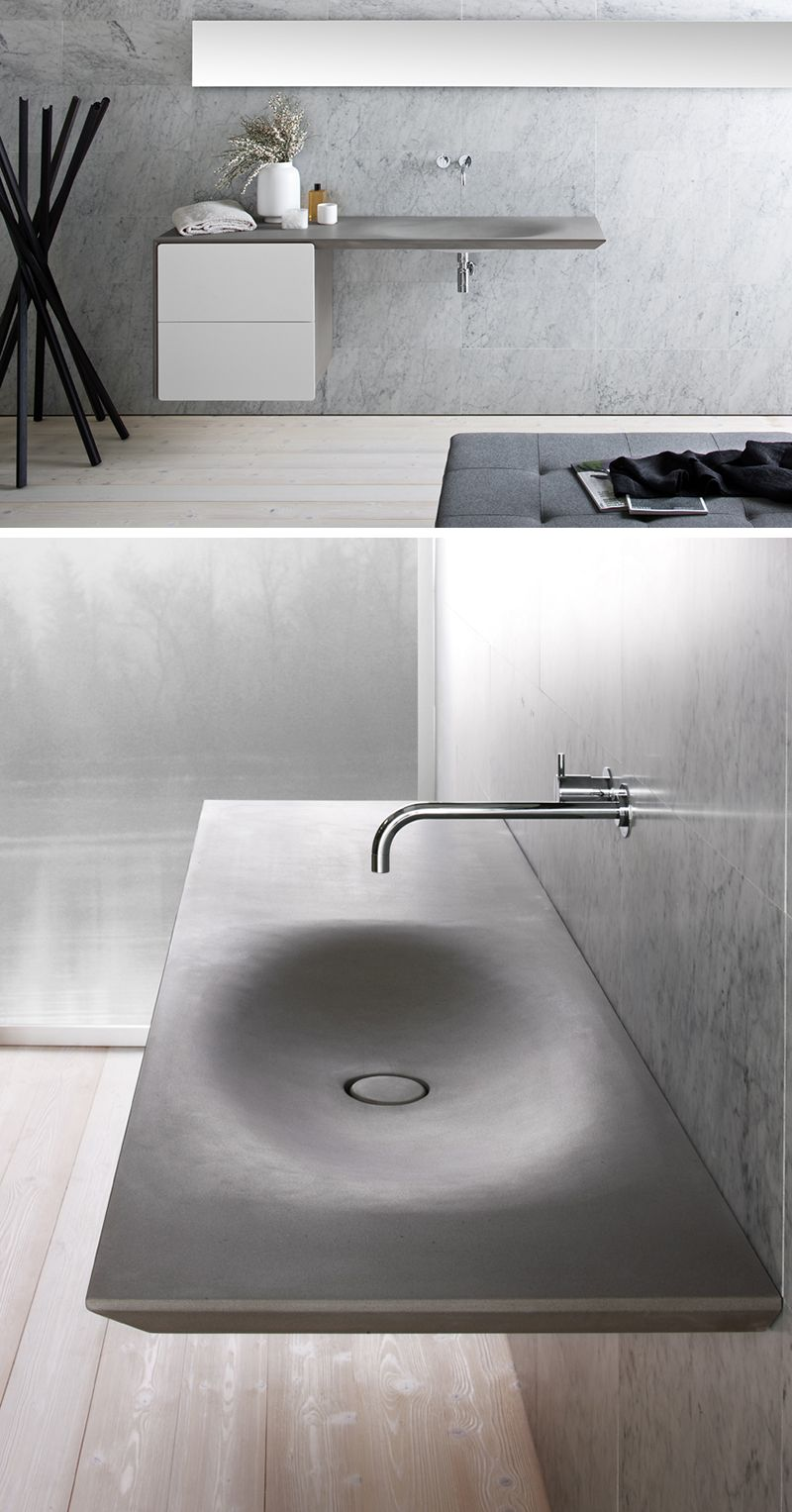 Genial This Modern, Seamless Grey Stone Sink Is Wall Mounted With Two White  Drawers And A Chrome Faucet.