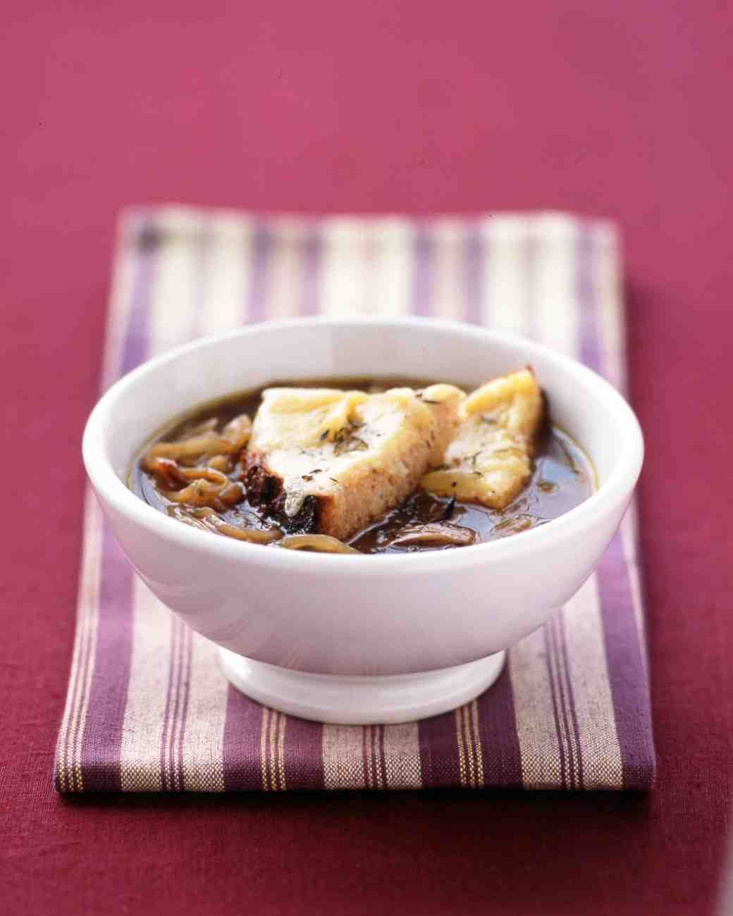 French Onion Soup - two toasted baguette slices topped with a mixture of gruyere, fontina and swiss and put under broiler #soup #onion