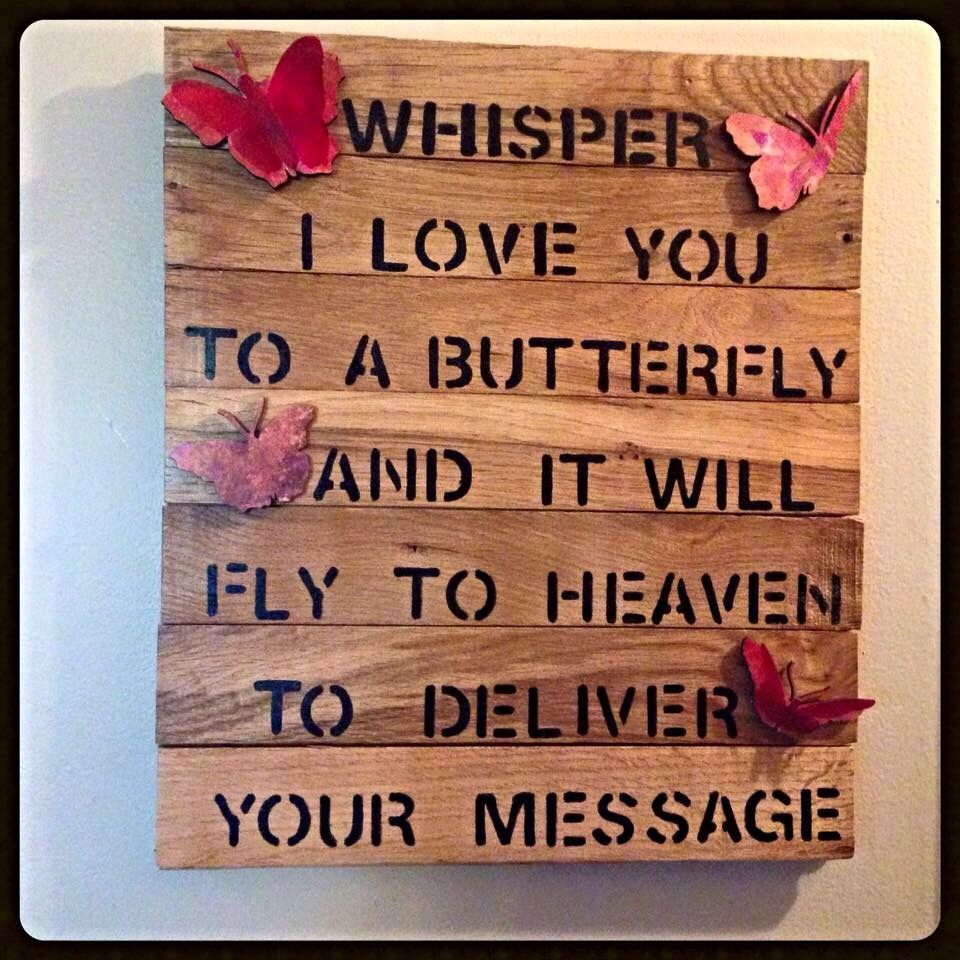 Butterfly sign made with tongue and groove wood flooring