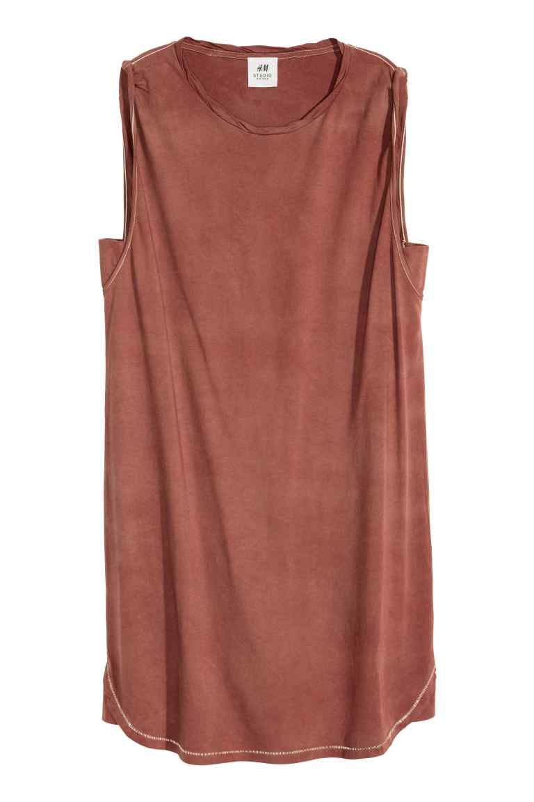 H&M Studio SS 16 Collection - Vest top dress: STUDIO COLLECTION/CONSCIOUS. Short, sleeveless dress in washed jersey made from organic cotton with stitching in a contrasting colour, a twisted trim around the neckline and a rounded hem with gores in the sides. The dress has been washed in tea to create a natural dye, so the appearance of each garment may vary.