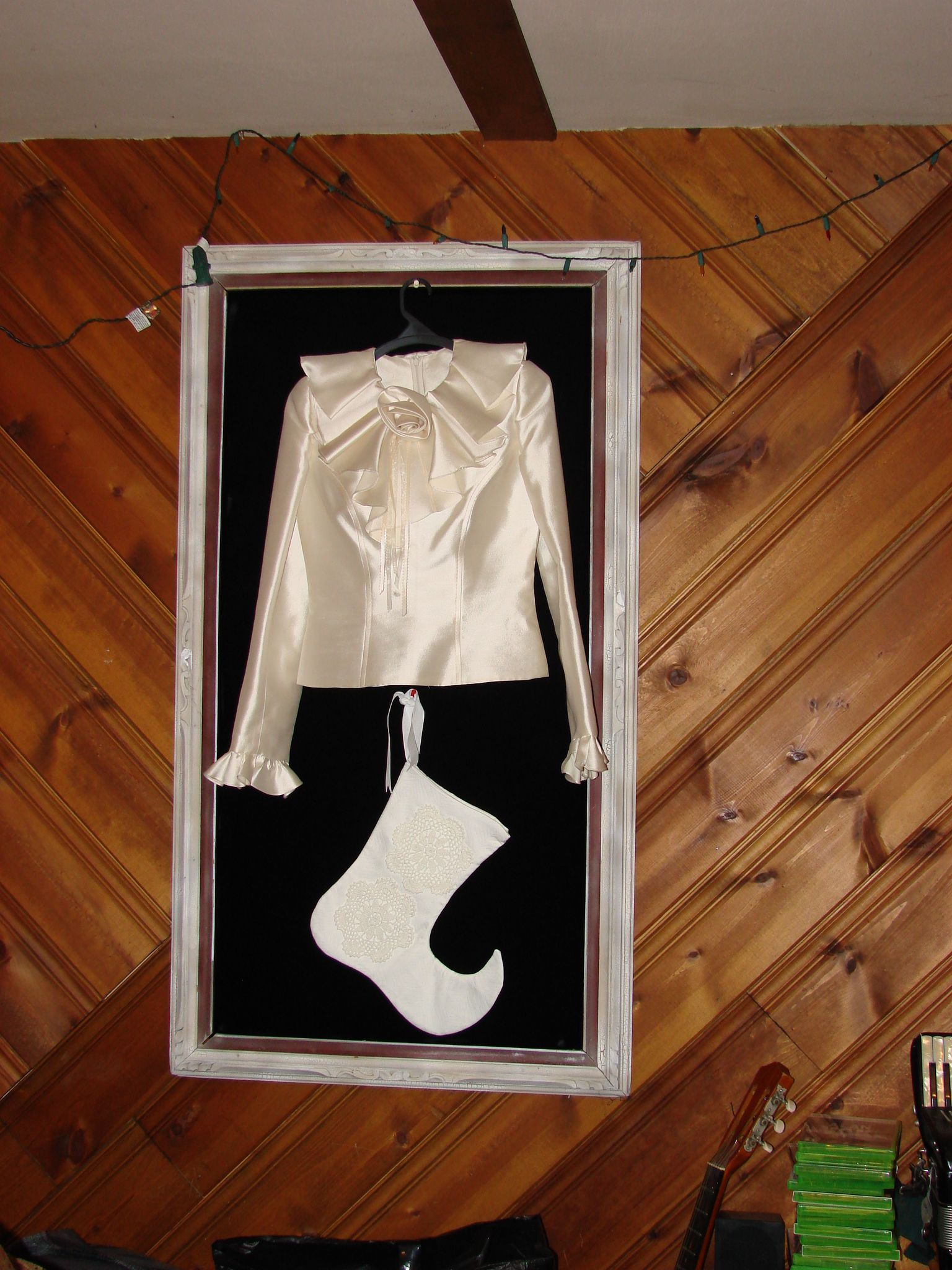 framed white ruffle top with white clown stocking