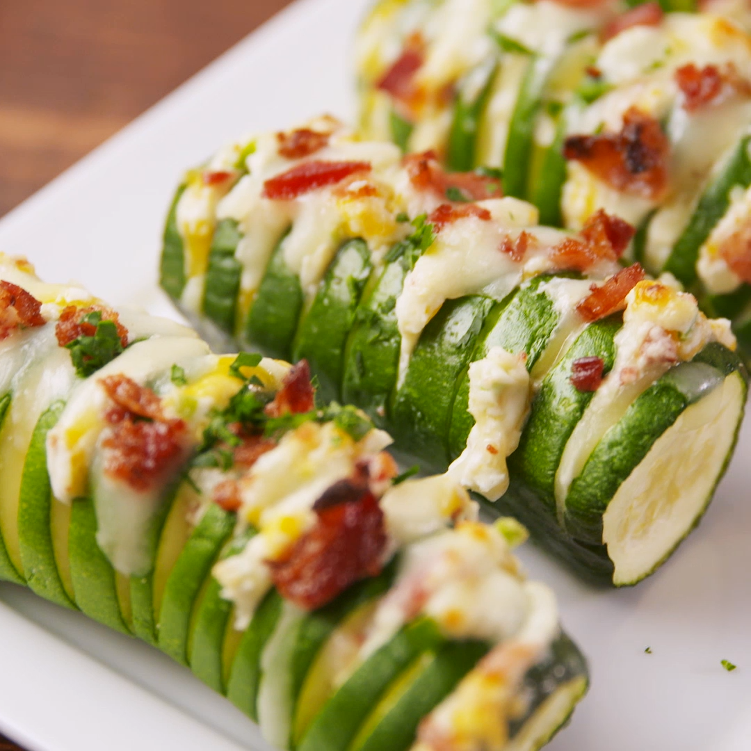 Jalapeño Popper Stuffed Zucchini is part of food-recipes - Make your side dishes more interesting with this Jalapeno Popper Stuffed Zucchini from Delish com