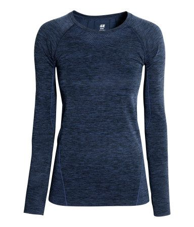 Dark blue melange. Fitted sports top in fast-drying, functional fabric with…