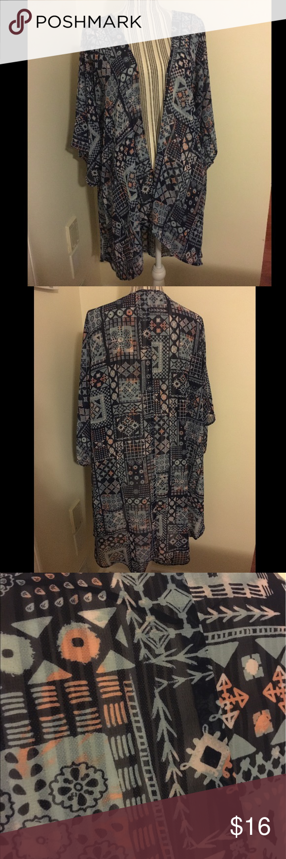Blue and pink patterned kimono beach cover up Super cute and light material. Loose fitting and flowing. Perfect as a light cover for the sun or beach, comfy. Can fit bigger or smaller sizes due to how loose it is. Worn once, in excellent condition. Color is like a blue and light pink or peach. Mudd Tops