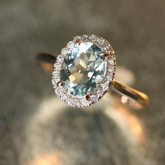 wedding rings teardrop #wedding #rings #weddingrings Handmade Natural Aquamarine Engagement Ring 9x7mm Oval Aquamarine Wedding Ring Halo Diamond Ring 14k Rose Gold (Other Metals Available) - This elegant and feminine Aquamarine ring features a 9x7mm oval shaped natural Aquamarine surrounde - #14k #9x7mm #aquamarine #diamond #engagement #Gold #Halo #handmade #Metals #natural #Oval #Ring #Rose #wedding
