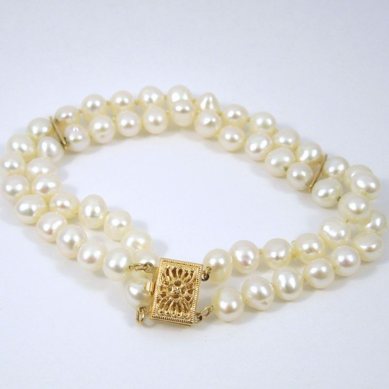 Double Strand, Freshwater Pearl Bracelet with 14K Yellow Gold Clasp. - $150