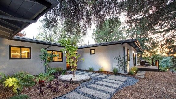 Bright Tones, Ornate Details And Walls Of Glass Enliven The Interiors Of  This Updated Atomic · Midcentury FireplacesRanch ...