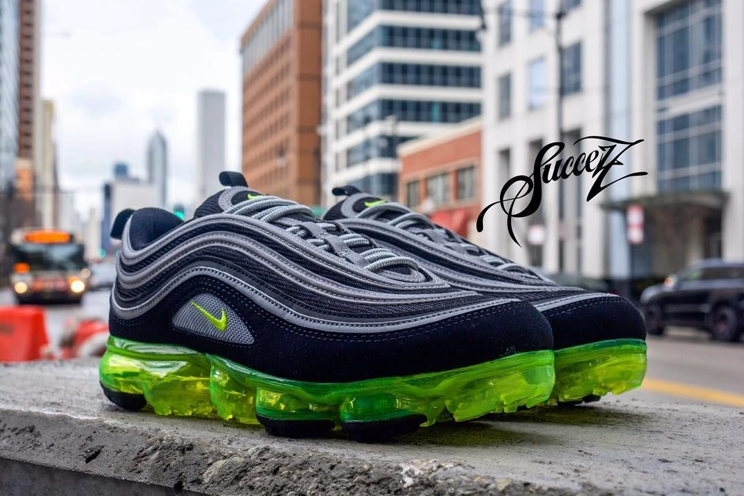4bcf618b7d81 Air Vapormax 97 Japan Dressed in a combination of Black Volt Metallic Silver  and White.