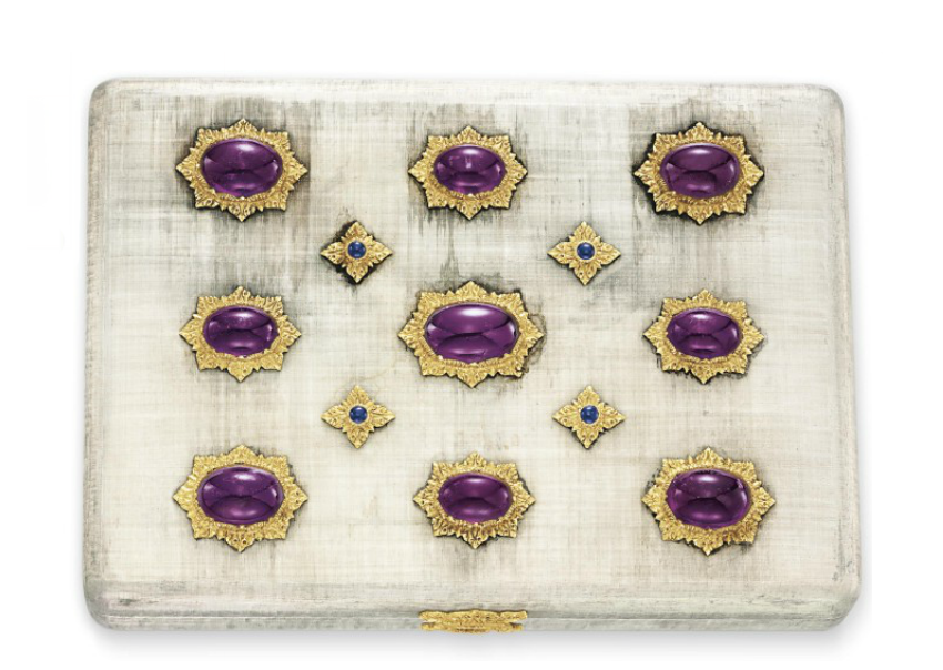 AN AMETHYST, SAPPHIRE, SILVER AND GOLD VANITY CASE, BY BUCCELLATI   The rectangular-shaped textured silver case set with rows of oval cabochon amethysts, each within a sculpted gold surround, spaced by smaller cabochon sapphires, opening to reveal a fitted mirror and gray suede compartment with removable pocketed liner, mounted in silver and gold, 5½ x 4 x 1 ins.  Signed Buccellati