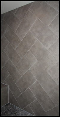 Herringbone Layout Of A 12 X 24 Tile In A Custom Shower Shower Tile Designs Shower Wall Tile Master Bath Shower Tile