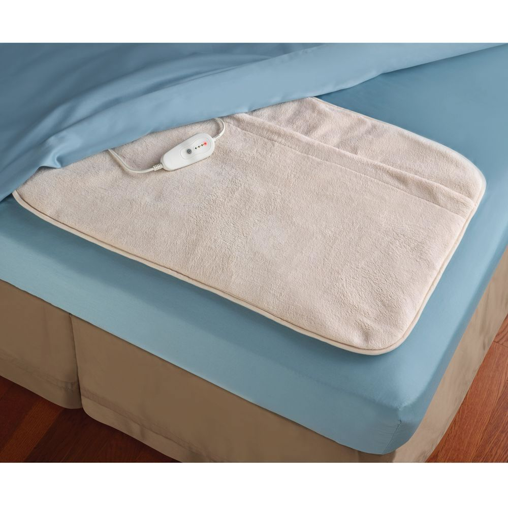 The Foot Of The Bed Warmer Hammacher Schlemmer Delivering The Perfect Amount Of Heat To Keep Toes Toasty Without Overh Foot Of Bed Foot Warmers Hammacher Schlemmer