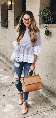 Light pleating and the eyelet cuffs give the top a flouncy, youthful hemline.Eyelet Glee Striped Dolly Top featured by Theteacherdiva Blog
