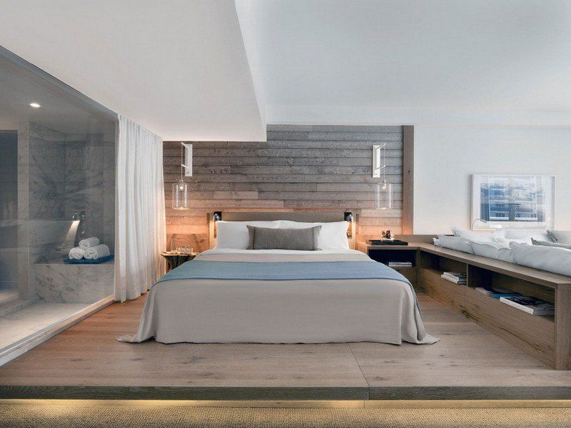 aménagement intérieur d'une chambre adulte avec un grand lit