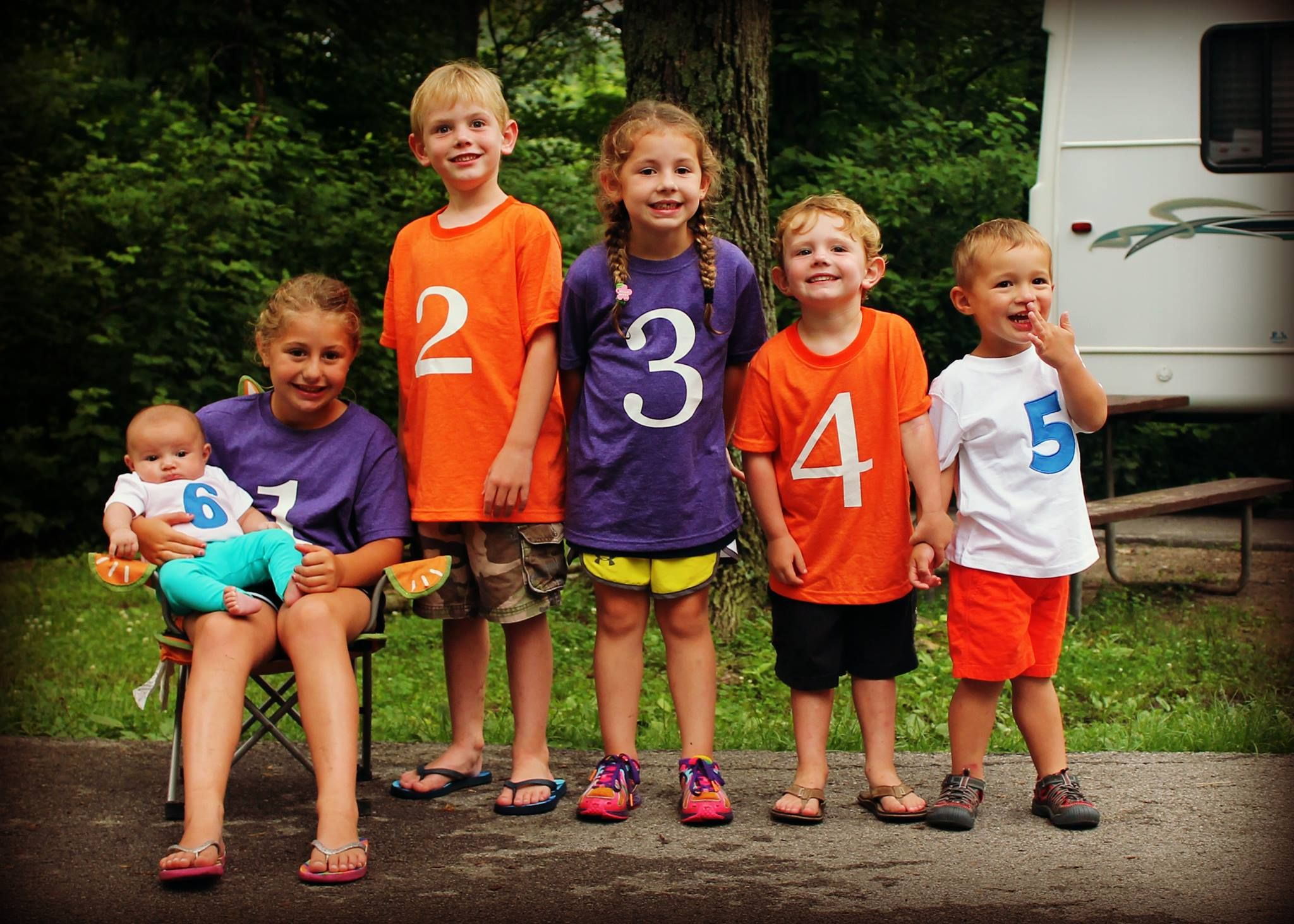 Cousin photo...each kid has a shirt with their birth order number on ...
