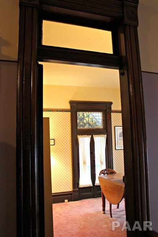 Transom windows over the doors (clear interior/stained-glass ...