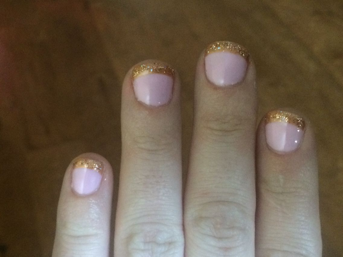 A new take on French manicure.  Pink base with copper gold tips topped with a bit of glitter.   Done at Blush nail bar in rock hill sc.
