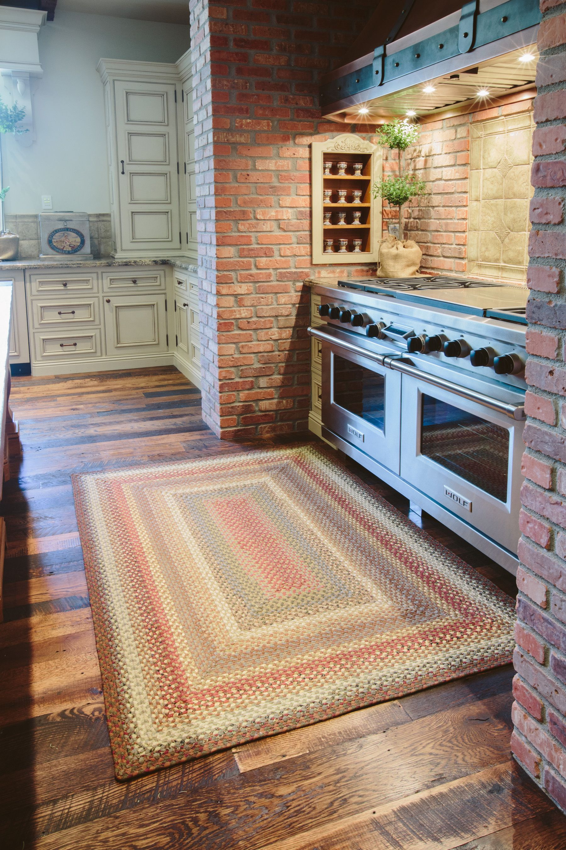 Eclectic Kitchen With Brick Cooking Area The Walls And Wood Floors Look Primitive