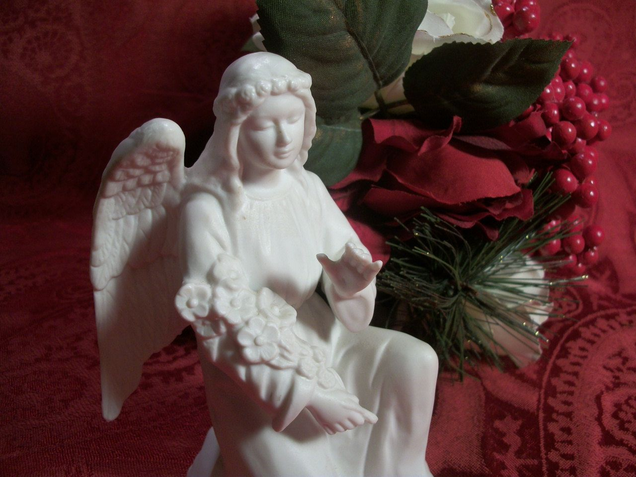 White Kneeling Angel with Flowers