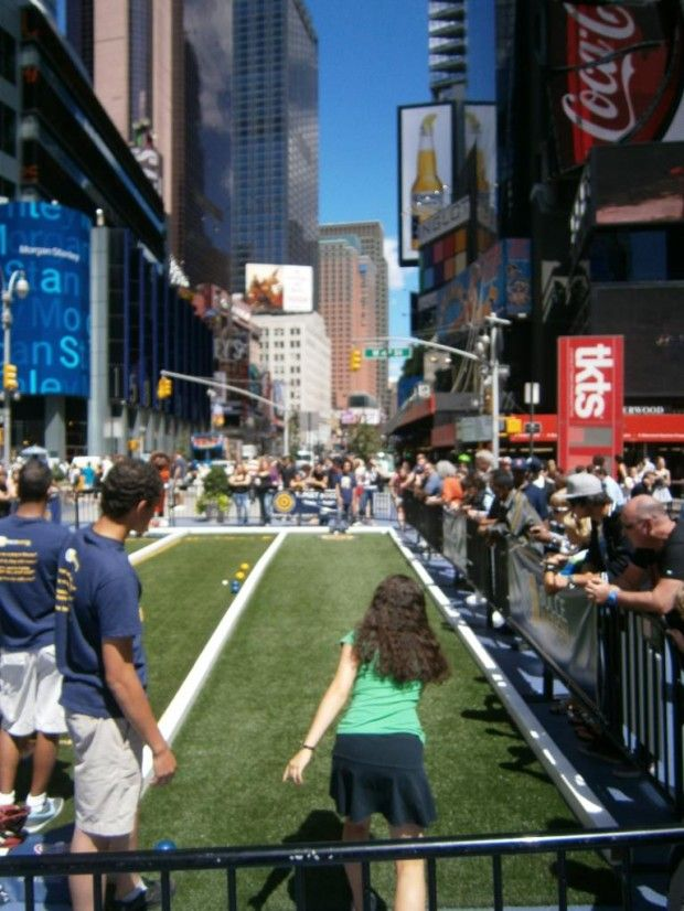 Mobile bocce or 39 bowls 39 courts set up in the middle of the for Activities in times square