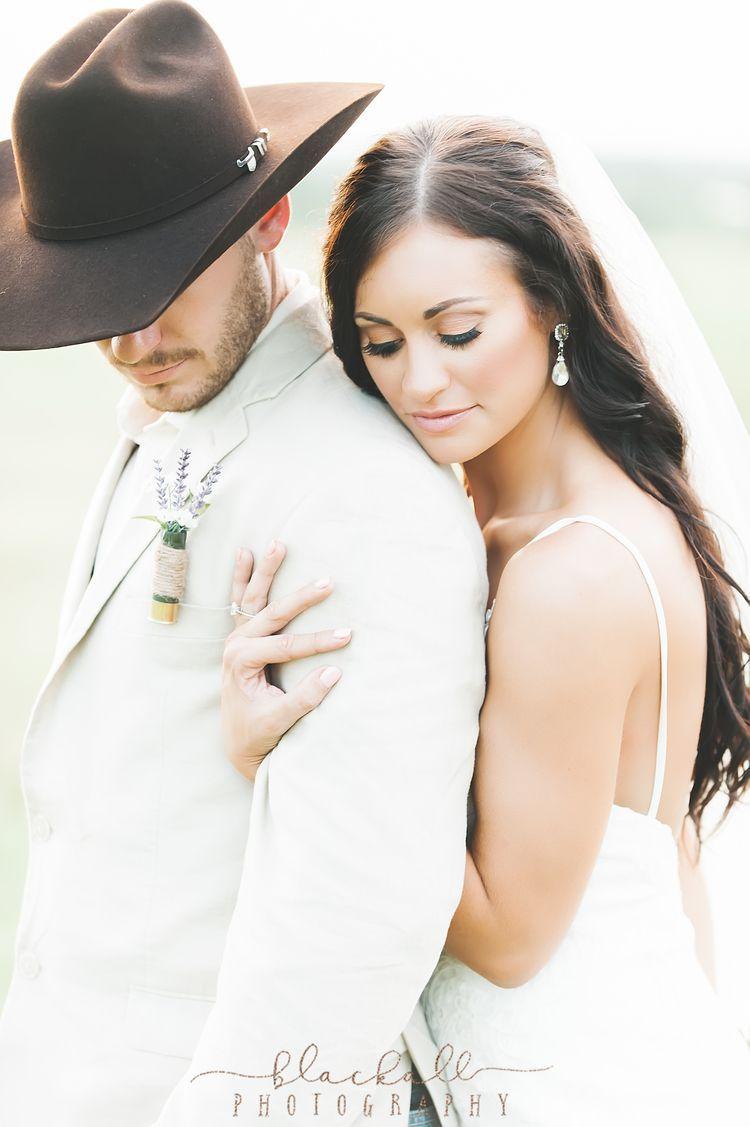 Country wedding featuring an essense of australia wedding dress