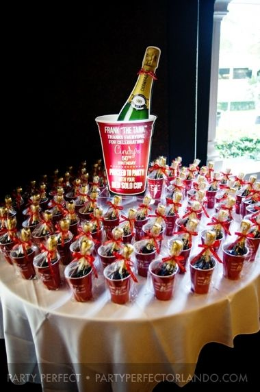 Cool 50th birthday party favor table display. Find cups here: http://www.cool-party-favors.com/red-solo-style-cups-personalized.html