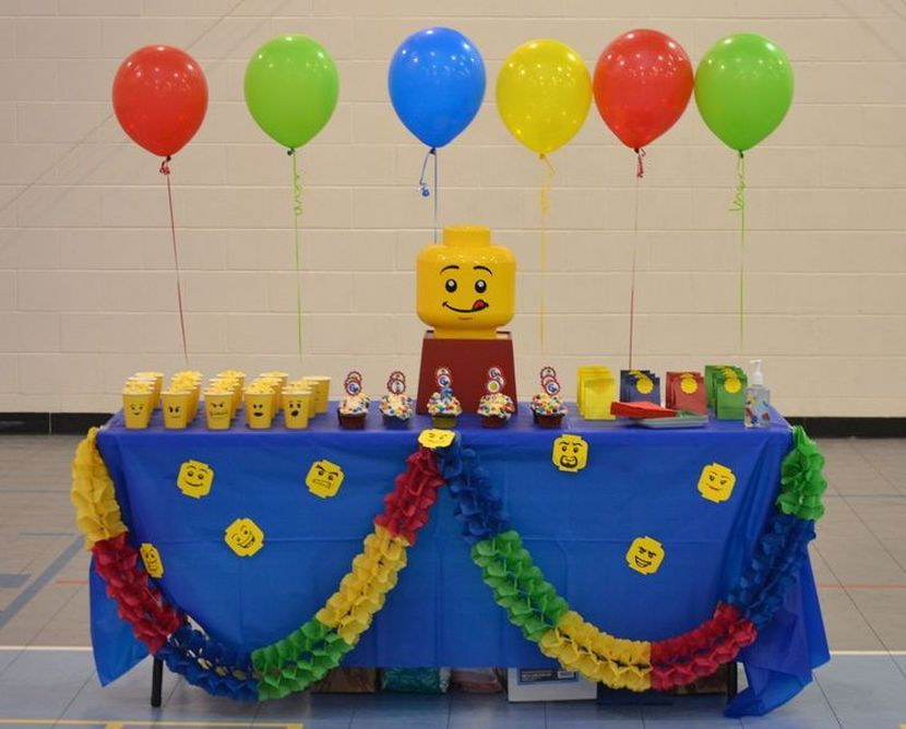 DIY Lego themed party table with Lego face embossed paper cups ...