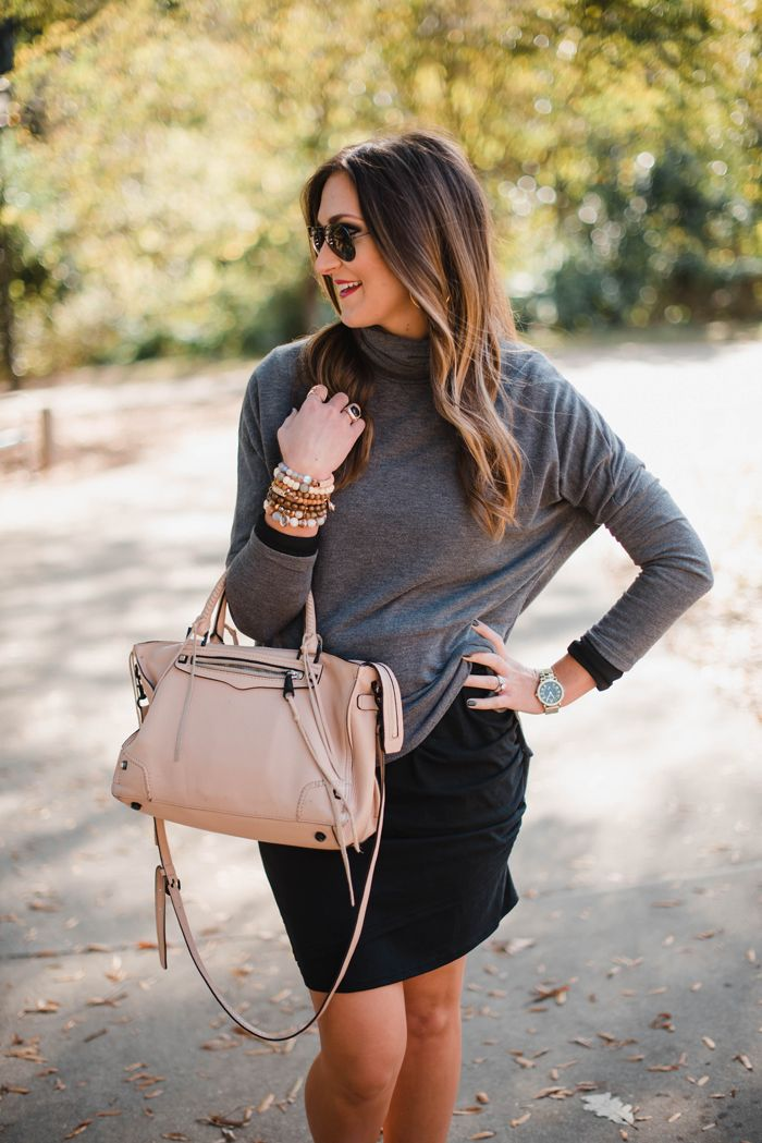 Blogger Mallory Fitzsimmons of Style Your Senses shows how to layer with a black body con dress and a lightweight turtleneck for an athleisure look that's comfortable and casual