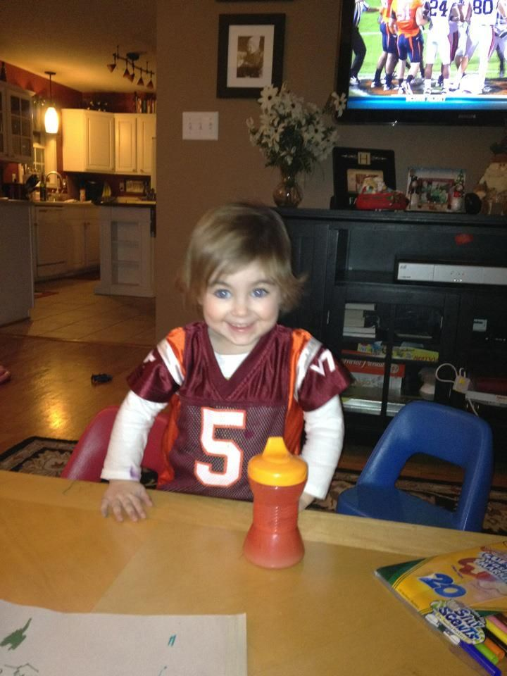 Cami watching the VT game...sort of.