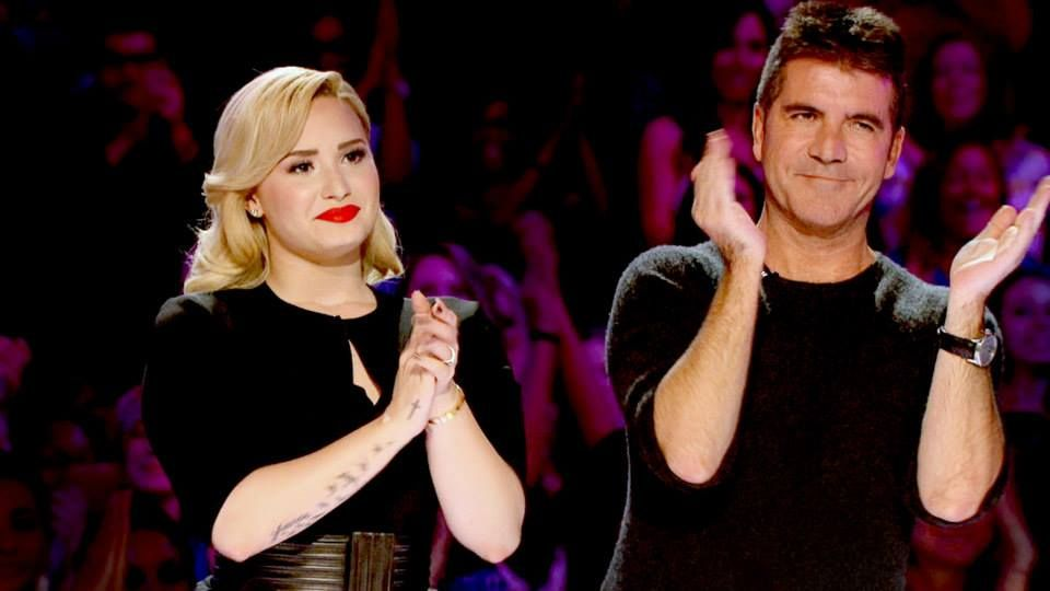 A big standing O from Demi Lovato and Simon Cowell