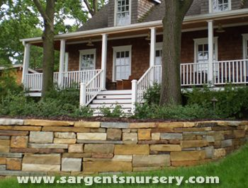I love this custom built stone wall, done by Sargent's in Red Wing. It created a large patio space off of the front porch.