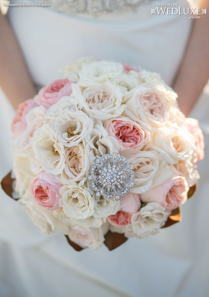 WedLuxe: bride's #bouquet of pink and cream roses with a crystal brooch tucked inside