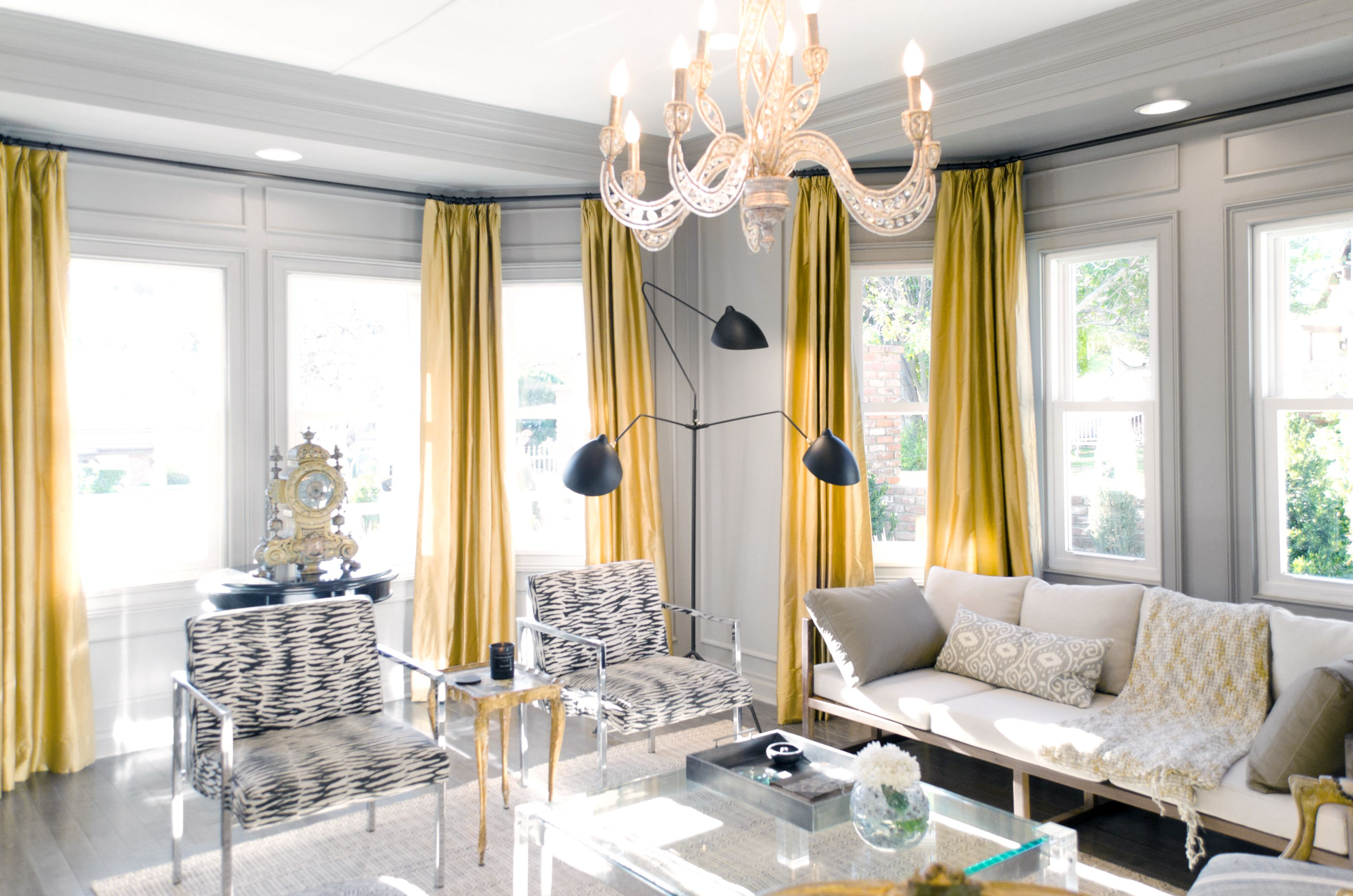 gold curtains against gray walls by Lukas Machnik Home