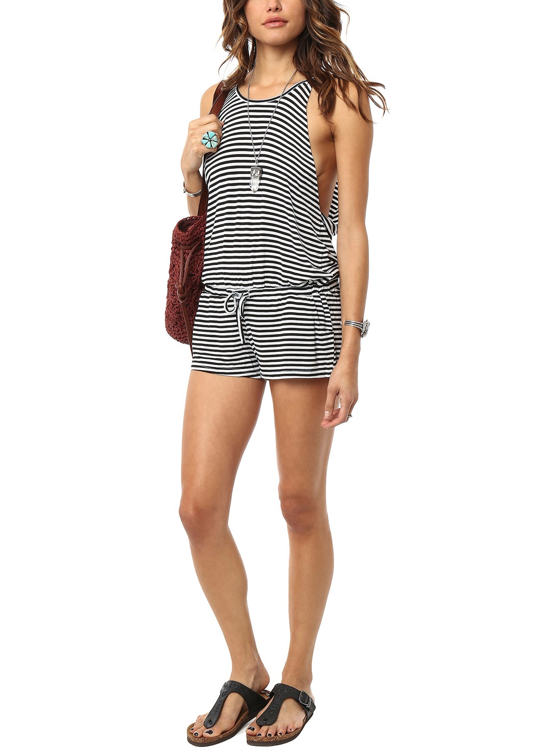 85770b983426 Loving this airy black and white striped romper paired with sandals for an  easy ensemble that is perfect for hitting the beach.