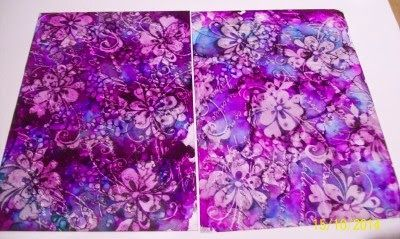 By Kim Reygate. Acetate & Alcohol Ink Background. Apply drops of alcohol ink to felt pad of blending tool. Tap all over acetate, turning the tool as you move. Now add a few drops of blending solution to felt pad; use pad on another piece of acetate to create a paler background. Using archival ink, stamp an image repeatedly and randomly over the alcohol ink pieces. Let dry briefly; wipe away the ink using dry cloth/paper towel. Pretty -- and fun! Photo tutorial on website.