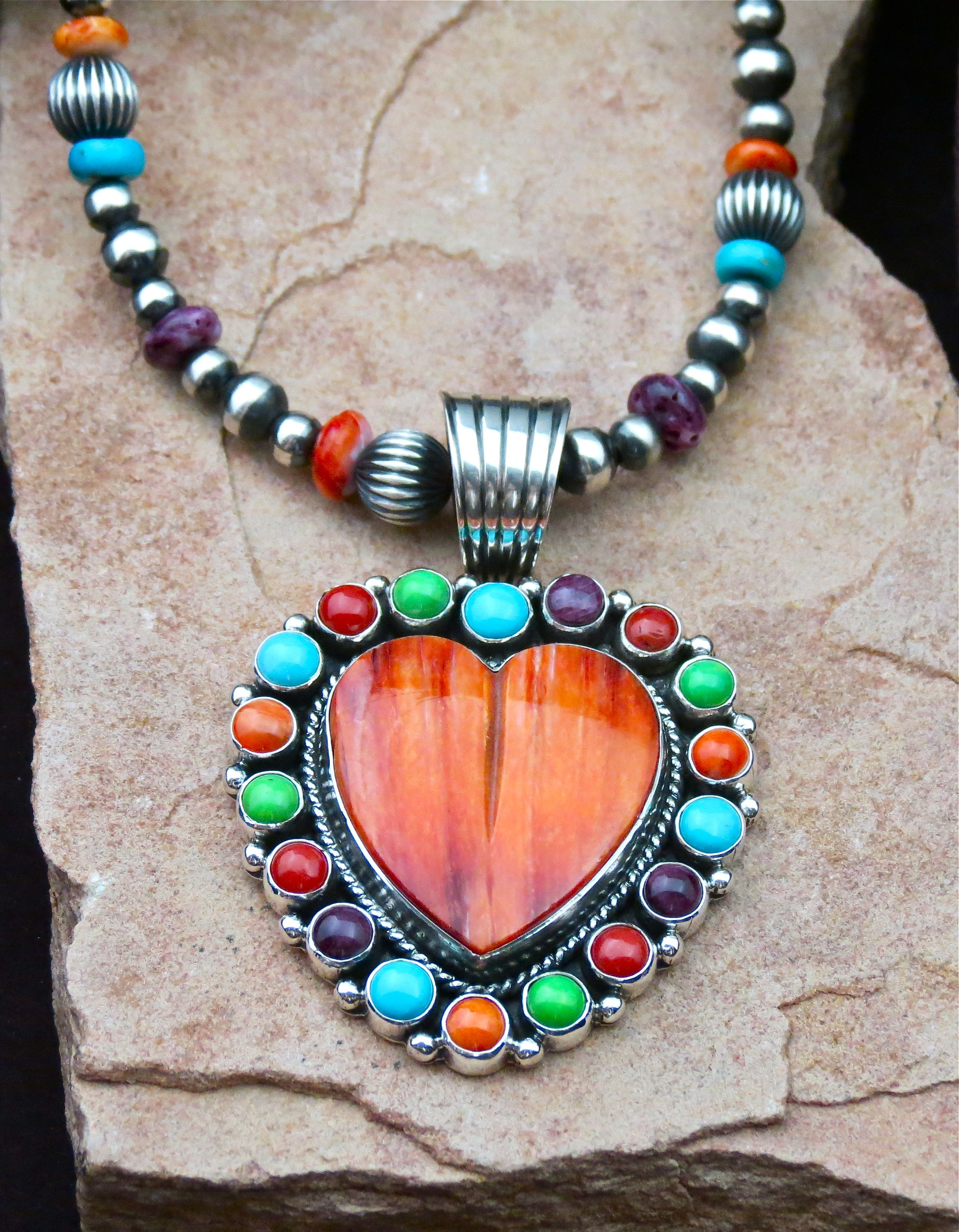 #spinyoystershell Heart shaped necklace and pendant from designer #EricBonecutter available at www.spiritofsantafe.com