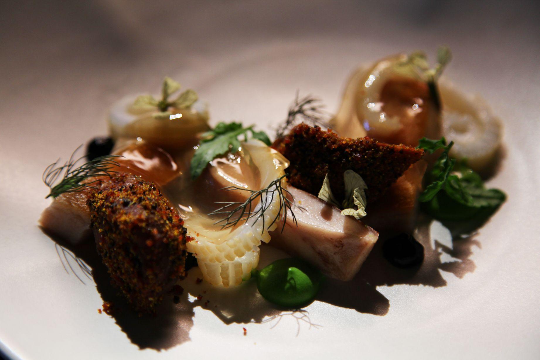 Slow cooked pork cheek with fennel black garlic and calamari