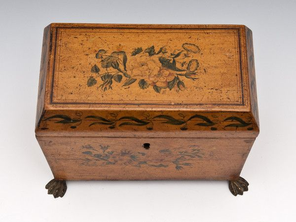 Penwork Tea Caddy with painted floral sprays, leaf pattern around its canted lid and stands on four lion pad brass feet.http://www.hamptonantiques.co.uk