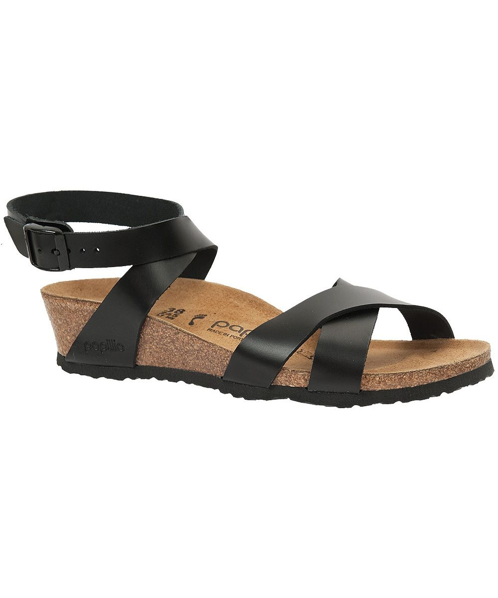 91e0a51a528 Papillio by Birkenstock. Black Leather Strappy Lola Wedge Sandal. Wrap  Around Ankle Strap with Buckle. Criss Cross Straps at Toe. Wedge Heel. Cork  Footbed.