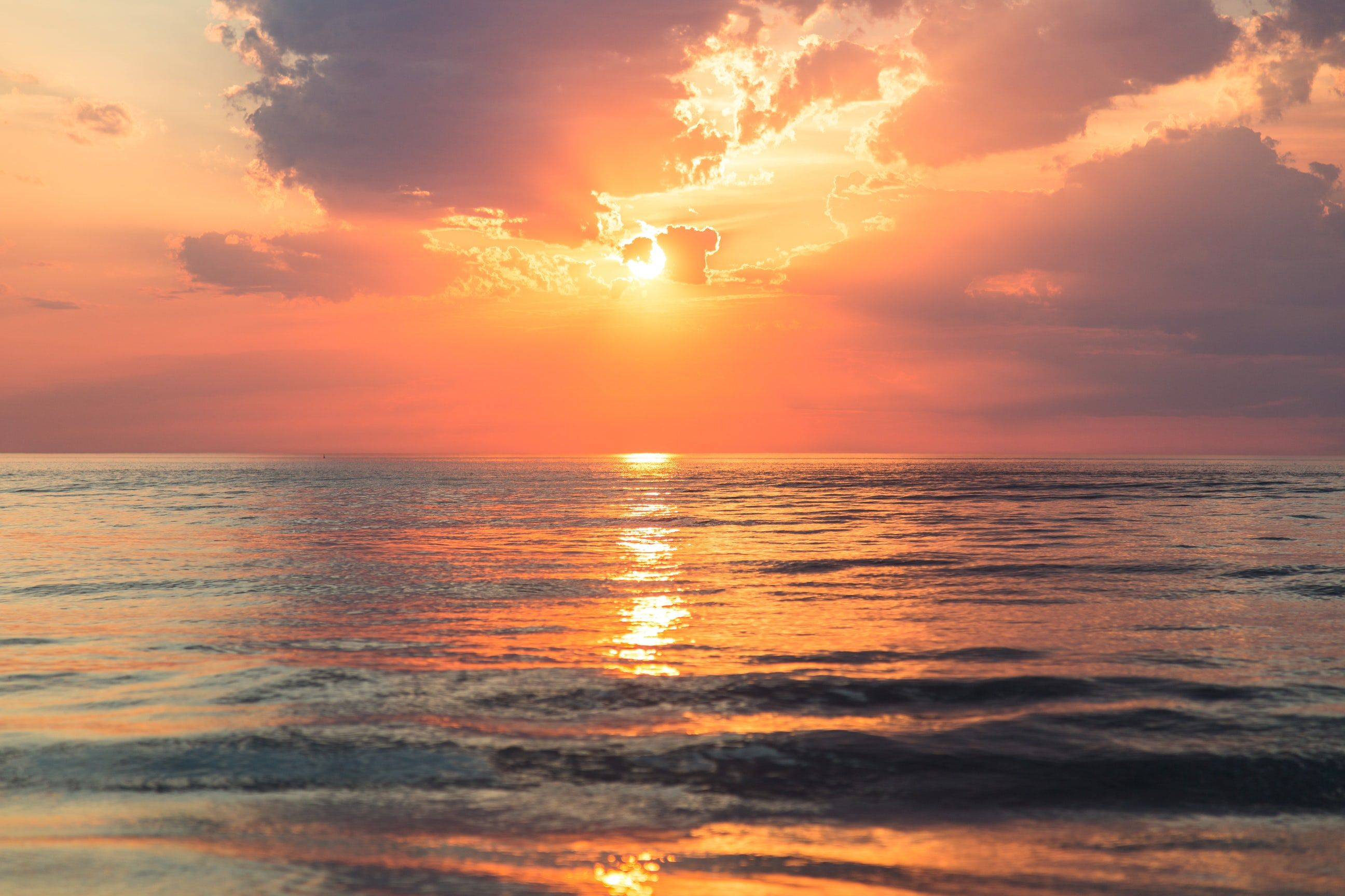 Sea Under White Clouds At Golden Hour Sunset Images