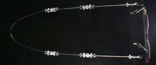 Eyeglass Chain Holder AXS100-09 . $7.50. Simple Silver chain necklace with Crystal Clear beads and flower design that holds optical and sunglasses. Great for everyday wear!