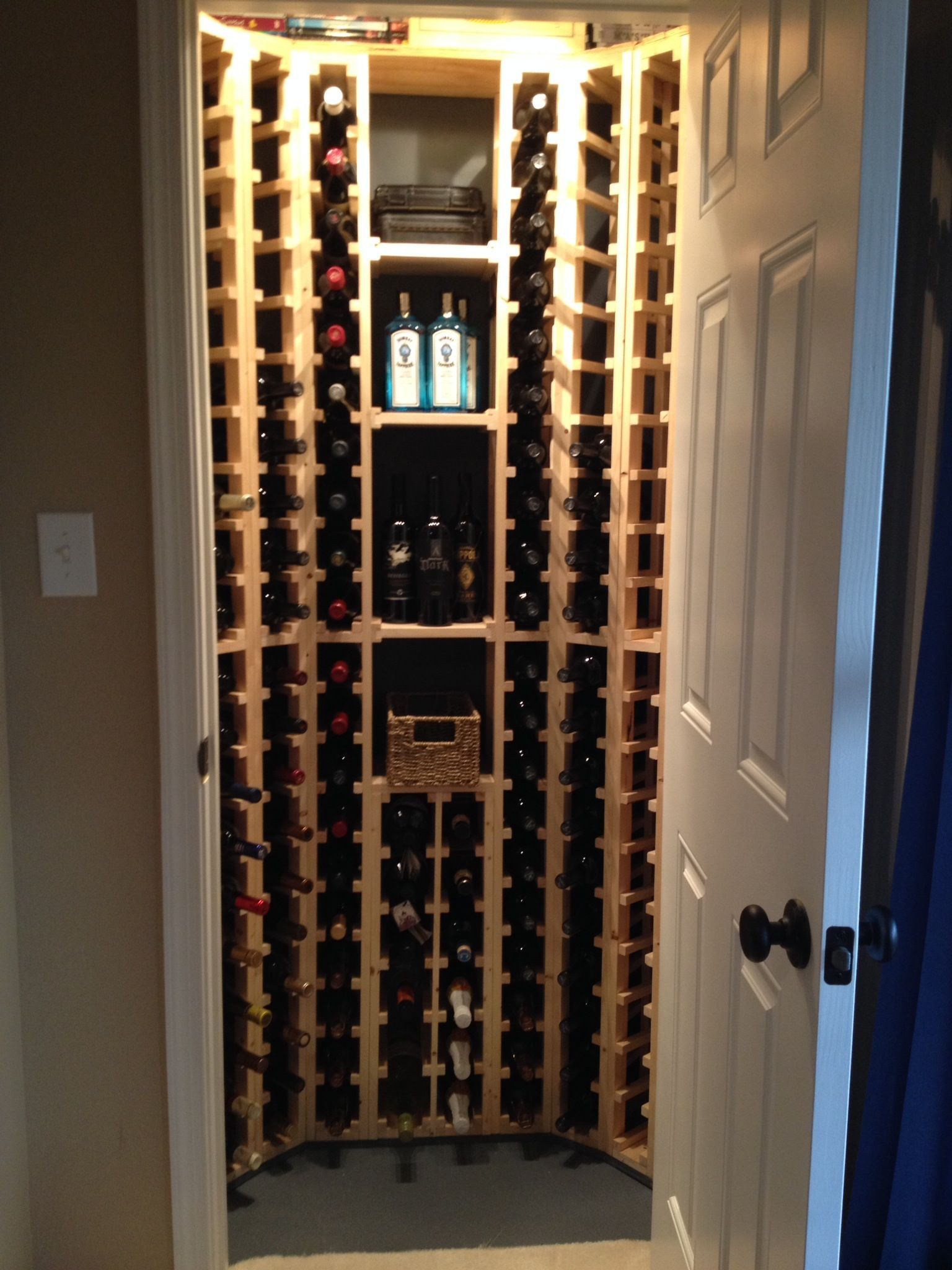 "my husband built our wine ""cellar"" by scratch for a small closet"