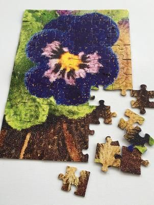 Pansy puzzle. Vintage looking bold and bright pansy puzzle brings nothing but pure fun and warm rustic feel to your home. Skill level: Intermediate.